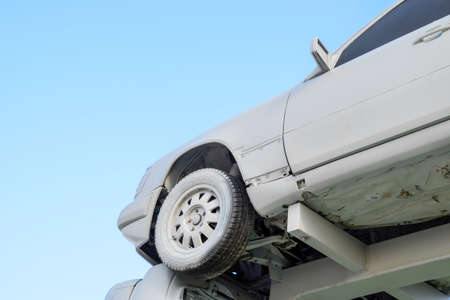 Homemade sculpture of three cars. Monument to the cyrillic letter P. Public Monument Stock Photo
