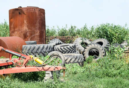 A bunch of old tires from tractor wheels. Protectors from the wheels of combine harvesters and tractors