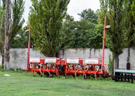 Russia, Temryuk - 15 July 2015: Seeder for sowing seeds of field crops. Trailer Hitch for tractors and combines. Trailers for agricultural machinery.