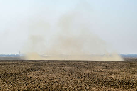Dust storm. Tornado in the field. Clubs of dust