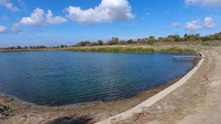 An artificial lake for fishing. A bridge for fishermen on the lake. Lake fishing