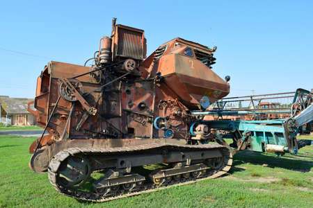 Russia, Poltavskaya village - September 6 2015: Old rusty disassembled combine harvester. Combine harvesters Agricultural machinery