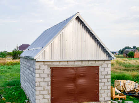 View of the garage in a plot of land. construction. Фото со стока