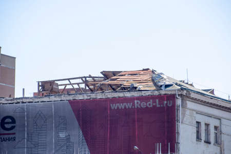Novorossiysk, Russia - September 29, 2017: Wind-blown roof from the building. Destruction of the roof element of the house. Consequences of the hurricane.