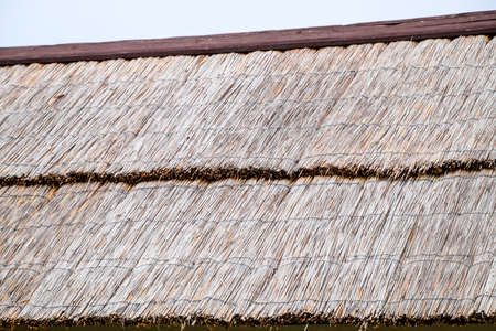 The slope of the roof of reeds and straw. Ancient building materials.