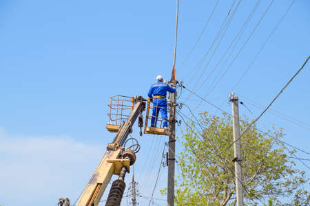 Slavyansk-on-Kuban, Russia - 24 April, 2018: Electricians repair the power line. Workers are locksmith electricians.