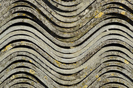 Corrugated slate lies in a pile, side view background texture of slate Stock Photo