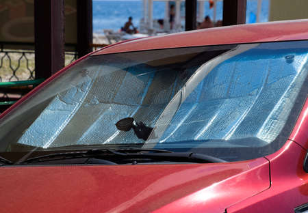 Protection of the car panel from direct sunlight. Sun Reflector windscreen. 스톡 콘텐츠