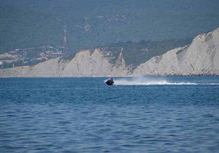 Novorossiysk, Russia - August 06, 2018: A man is riding a hydrocycle. Sea beach of the Broad Beam near the city of Novorossiysk. Éditoriale