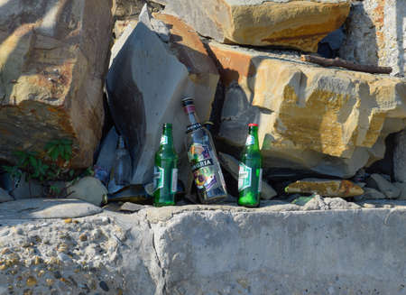 Novorossiysk, Russia - August 06, 2018: Empty bottles of alcohol. People left garbage. The beach of Novorossiysk