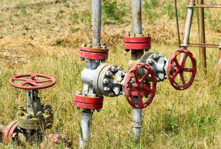 Manual shut-off valve on oil well. Oil well wellhead equipment Stock fotó