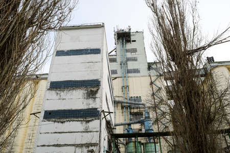 Building for storing and drying grain. Soviet-built elevator. 版權商用圖片