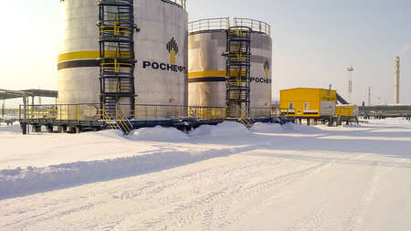 Russia, Nefteyugansk - January 24, 2016: A view of oil field equipment. Tanks with oil owned oil company Rosneft. Editorial