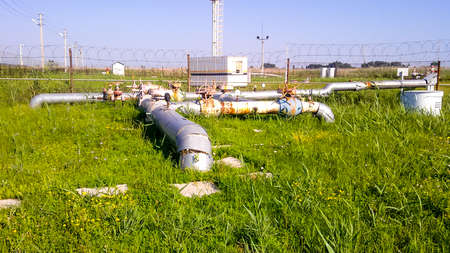 Oil industry object. Technological pipelines and equipment. Oil field. The equipment of crafts , iron designs and pipes