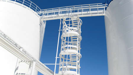 The tank with water and a ladder. Equipment for primary oil refining. 스톡 콘텐츠