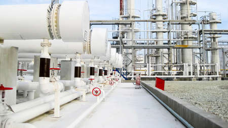 Heat exchangers in a refinery. The equipment for oil refining. 免版税图像