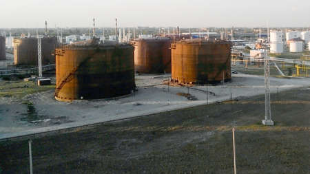 Tank the vertical steel. Oil refinery. Equipment for primary oil refining.