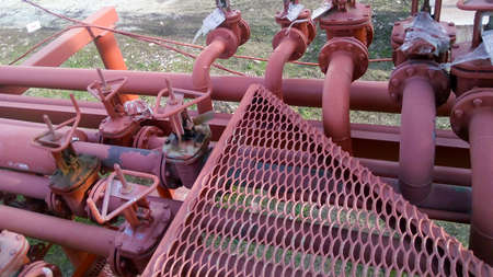 Valves on the pipeline for pumping oil. Pipes at the refinery. Stock Photo