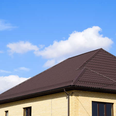 Decorative metal tile on a roof. Types of a roof of roofs. Decorative metal on the roof of the house. Stock fotó