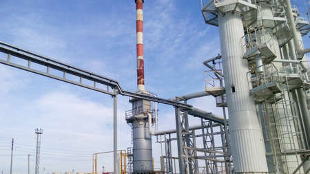 Distillation columns and heating furnace. The equipment for oil refinery. Stock Photo
