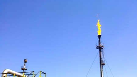 Flare for flaring associated gas. The end point of the pressure relief system on the oil facility Imagens