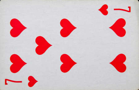 playing cards The playing seven card of hearts, the suit of hearts.