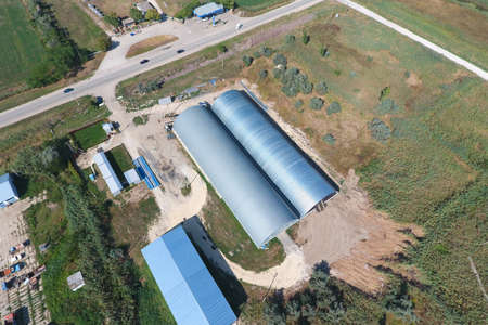 Top view of the hangars. Hangar of galvanized metal sheets for the storage of agricultural products and storage equipment.
