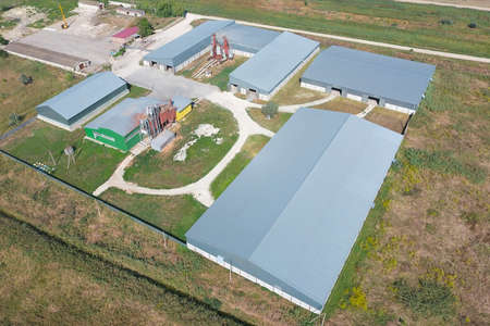Top view of the hangars. Hangar of galvanized metal sheets for the storage of agricultural products and storage equipment. Stock fotó
