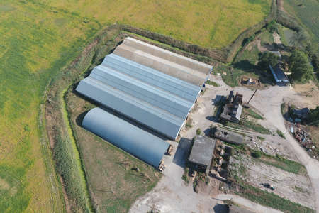Top view of the hangars. Hangar of galvanized metal sheets for the storage of agricultural products and storage equipment. Standard-Bild
