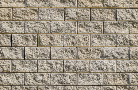 Background from the wall of white brick. yellow beige brick. Brick texture. Building background. Small items. Seamless design vintage style yellow beige cream tone brick wall detailed pattern textured background 스톡 콘텐츠