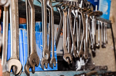 Krasnodar, Russia - October 18, 2017: Wrenches and other tools in the car garage. Редакционное