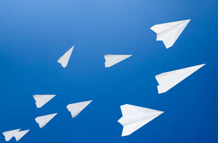 White paper airplanes against the blue sky. The symbol of freedom and privacy on the Internet 版權商用圖片