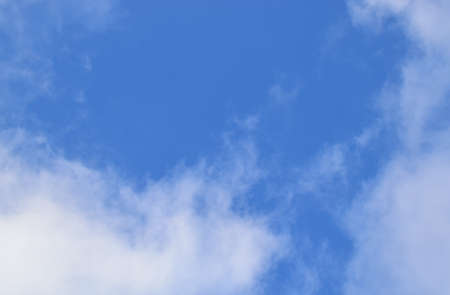 White cumulus clouds against the blue sky.