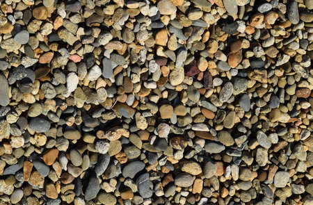 Background from small round crushed stone. A heap from a small pellet. Archivio Fotografico