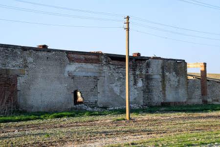 Old soviet brick abandoned building. Collapsing brick construction. white and red brick Reklamní fotografie