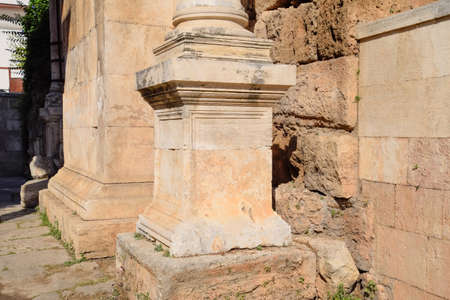 Element columns of ancient structures. Hadrians Gate, Antalya landmark. Ancient construction of the Gate of Hadrian
