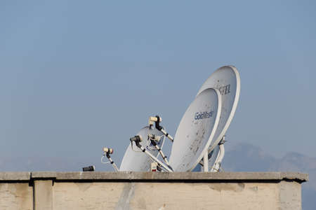 Antalya, Turkey - May 19, 2019: Satellite dish antenna for receiving a television signal on the roof of a building.