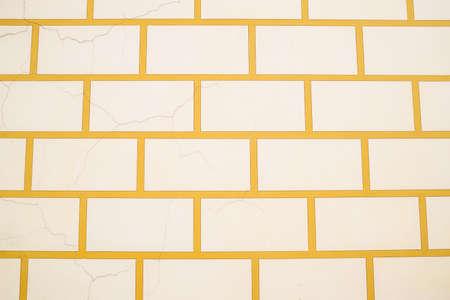 Background texture white bricks and yellow cement. Masonry of white stone. Stock fotó