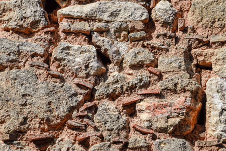 Background texture of an old masonry wall of limestone and cement. Stock Photo - 124528632