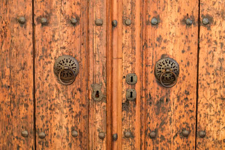 Vintage wooden gate door in the old building of the historic town of Kaleici. Stock Photo - 124529067
