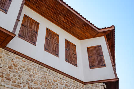 Ancient house with wooden shutters on the windows. City Kaleici in Turkey. Stock Photo - 124529081