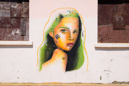 Antalya, Turkey - May 19, 2019: Graffiti on the wall, portrait of a girl with green hair.