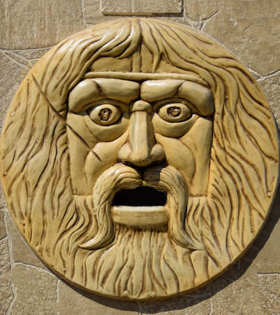 bas-relief, the face of a bearded and hairy man. Stock Photo - 124530781