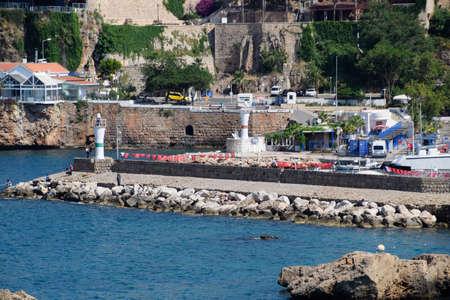 Antalya, Turkey - May 19, 2019: Lighthouse and embankment in Antalya, Turkey Pier for yachts Redactioneel
