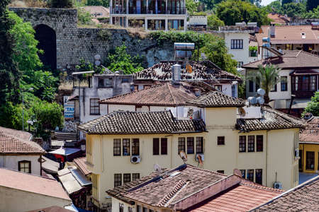 Antalya, Turkey - May 19, 2019: View from the observation deck on the roofs of the old buildings of the old city of Kaleici in Antalya, Turkey.