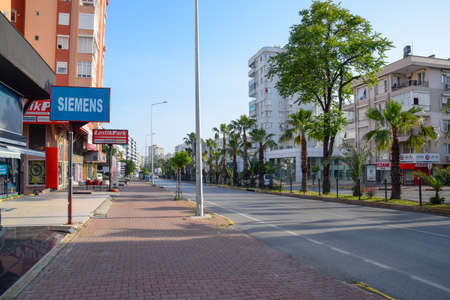 Antalya, Turkey - May 19, 2019: The streets of modern Antalya, the road, sidewalks and buildings