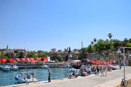 Antalya, Turkey - May 19, 2019: The old port of Antalya, excursion yachts in the port of Kaleici.