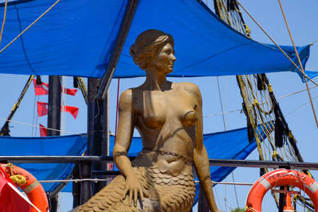 Antalya, Turkey - May 19, 2019: The statue of a mermaid with bare breasts. Statue on the excursion yacht.