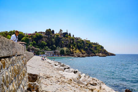 Antalya, Turkey - May 19, 2019: Antalya coast stone embankment and beach