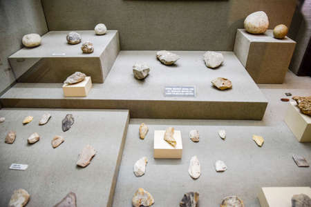 Antalya, Turkey - May 20, 2019: stone tools and knives with scrapers. Exhibits of the Antalya Museum of Antiquities, stone scrapers and knives and pottery.